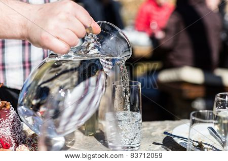 Pouring Water From Jug Into Glass