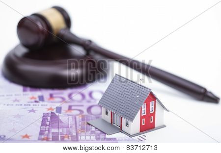 House with money and judge gavel