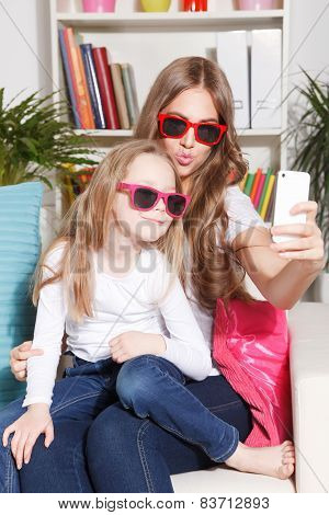Woman And Child Taking A Selfie