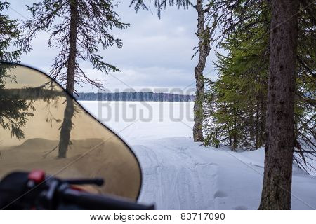 Snowmobile Heading For Frozen Lake