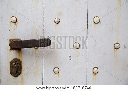 Rusty Wooden Door With An Old Door Handle Background