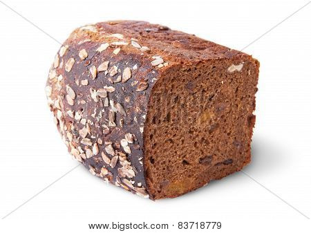 Lying Half Unleavened Black Bread With Seeds And Dried Fruit