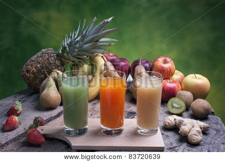 Mixed Fruit On A Wooden Board With Juice