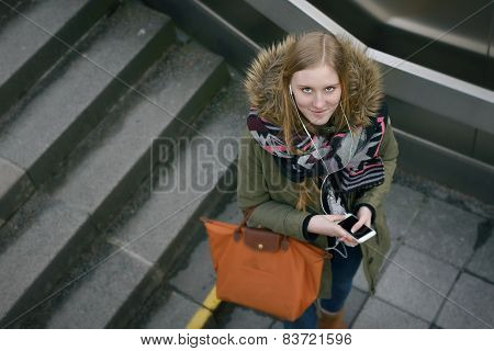 Stylish Woman In Winter Fashion At The Stairs