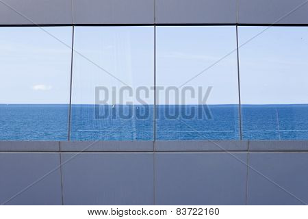 Sea Reflected In The Windows.