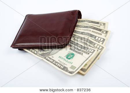 Old leather wallet with bills inside