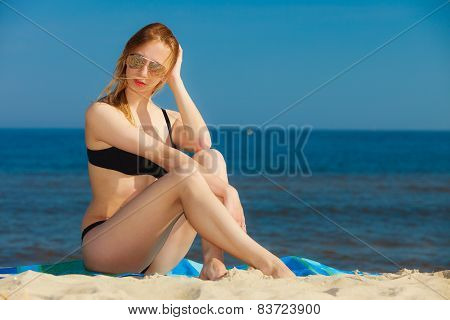 Summer Vacation Girl In Bikini Sunbathing On Beach
