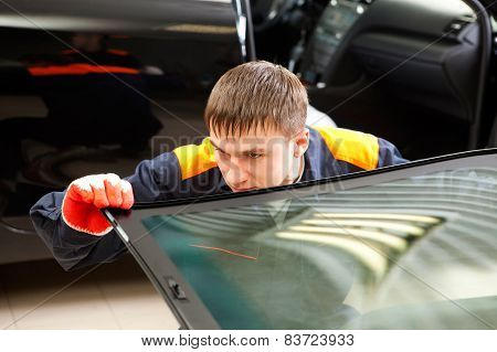 Real Mechanic Working In Auto Repair Shop