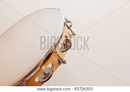 Horizontal Tambourine On Beige Background