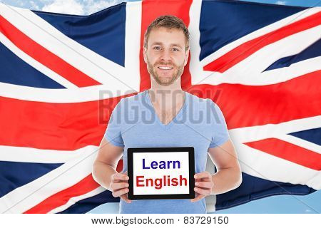 Man Holding Digital Tablet With Learn English Text