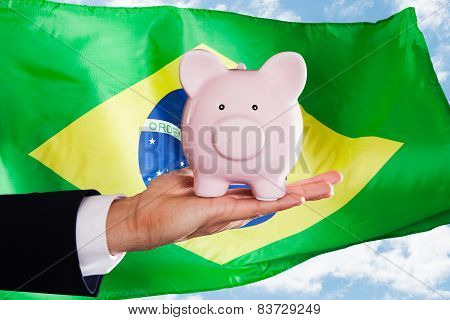 Brazilian Businessman Holding Piggybank