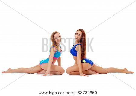 Seductive flexible girls doing stretching exercise