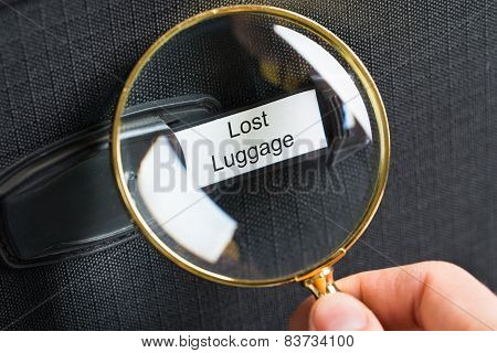 Magnifying Glass On Lost Luggage Label