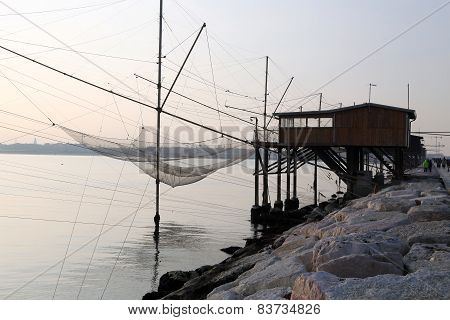 Stilt House Overlooking The Sea And Fishing Nets Of Fishermen
