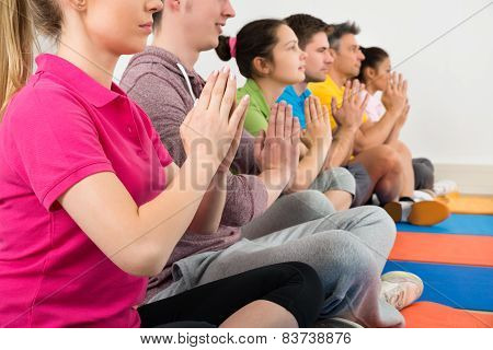 Multiethnic Group Of People Doing Meditation