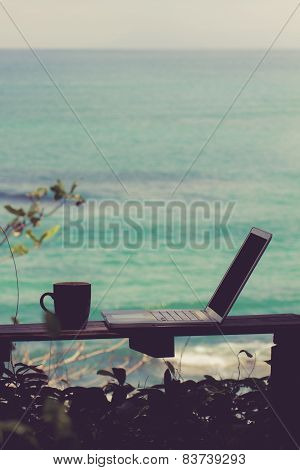 Cup Of Coffee And Laptop Ocean View