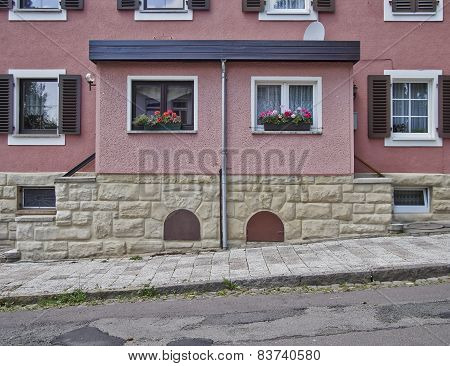 pink double house facade Altenburg Germany