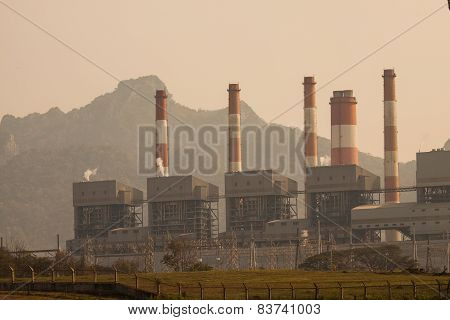 Industrial power plant with smokestack, the power plant production on hot condition in the mountain.