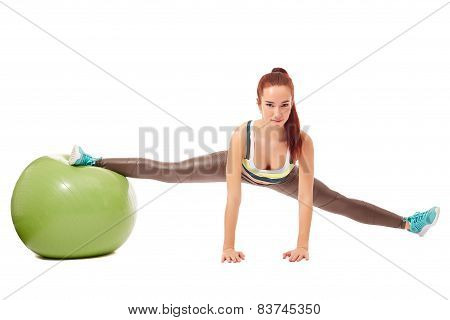 Charming flexible girl engaged in pilates