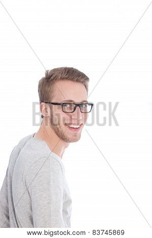 Happy Young Man With Glasses Looking At Camera