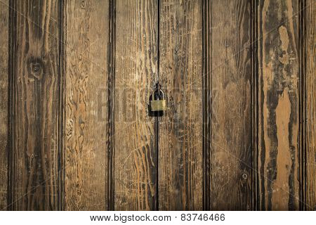 wood panels background with lock in the middle