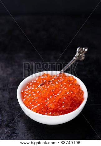 Salmon Caviar In White Bowl On Dark Background