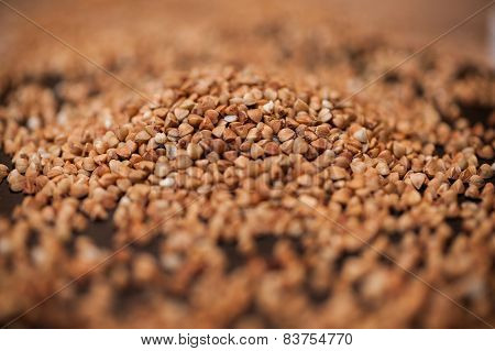 Buckwheat Pile On A Black Stone Background