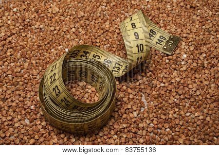 Yellow Centimeter Tape On Buckwheat Background