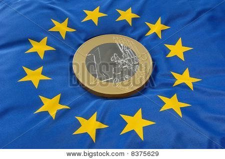 Euro coin on euro flag