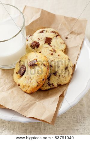 Crackling Cookies On Paper And Fresh Milk