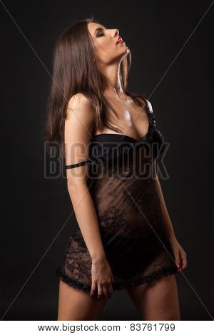 Sexy brunette woman in black tulle lingerie