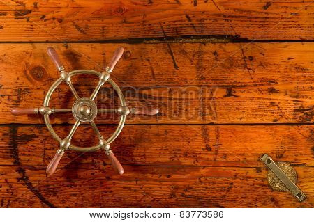 Ship's Wheel On Hatch Cover Table