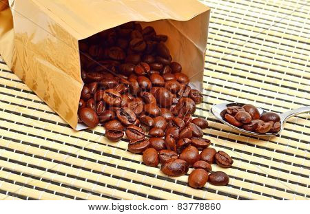 Coffee Beans On The Package On The Tablecloth