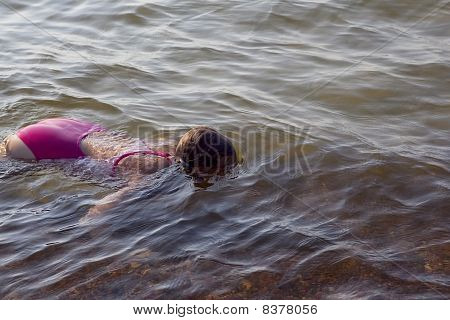 girl diving in the sea