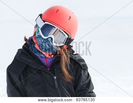 Girl Skier Portrait Wrapped Up Warm In Skiing Gear With Helmet And Goggles