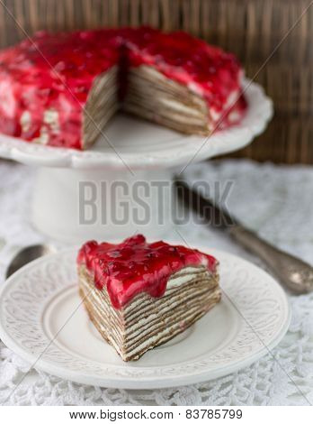 cake of chocolate crepes with curd cheese. selective focus