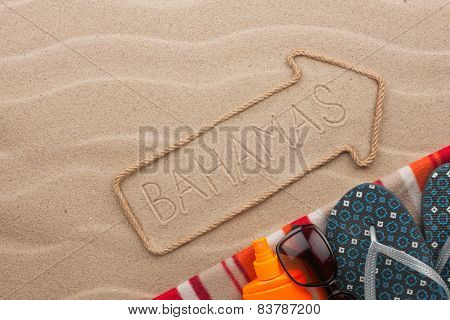 Bahamas  Pointer And Beach Accessories Lying On The Sand