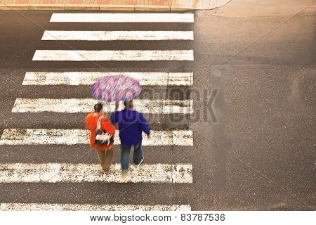 Couple On The Crosswalk