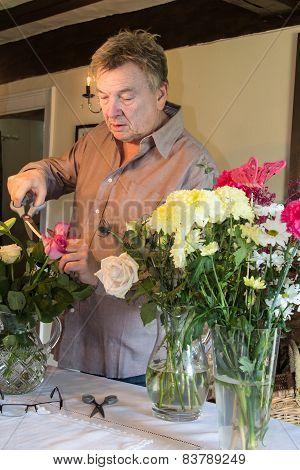 Man Arranging Flowers