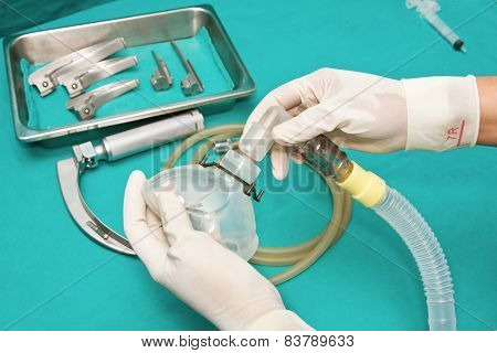 Set Of Tools For Intubation Tracheas With A Hand Of Doctor Connecting Tube