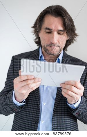 man with the tablet in his hands