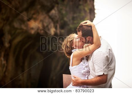 Groom Kissing And Embracing Bride