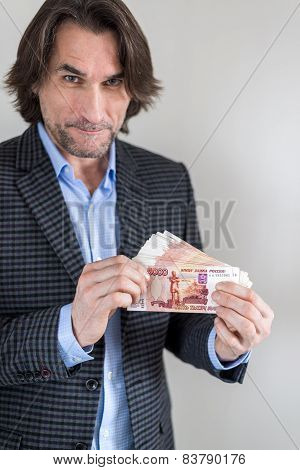 man with Russian money in hands