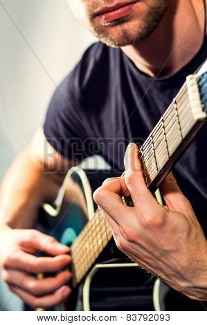 Man Playing On The Guitar, Picture With A Light Toning