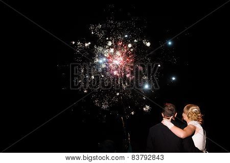 de and groom and Cluster of colourful fireworks