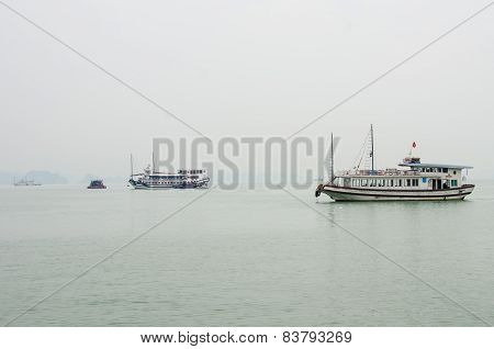 Tourist boats cruises among hundreds of small islands in Halong Bay