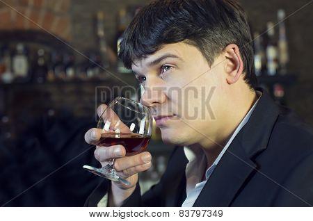 man drinking brandy