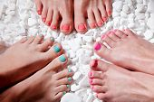 picture of toe  - Closeup of trendy colorful nail polished toes - JPG