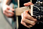 picture of guitar  - A musician playing on the acoustic guitar - JPG