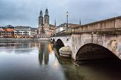 picture of zurich  - View on Grossmunster Church and Zurich Downtown in the Evening Switzerland - JPG